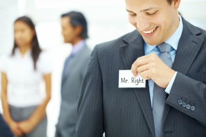 Young businessman pinning a nametag to his jacket - Copyspace